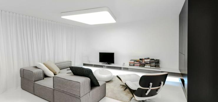 Le séjour de ce loft de ville moderne en noir et blanc