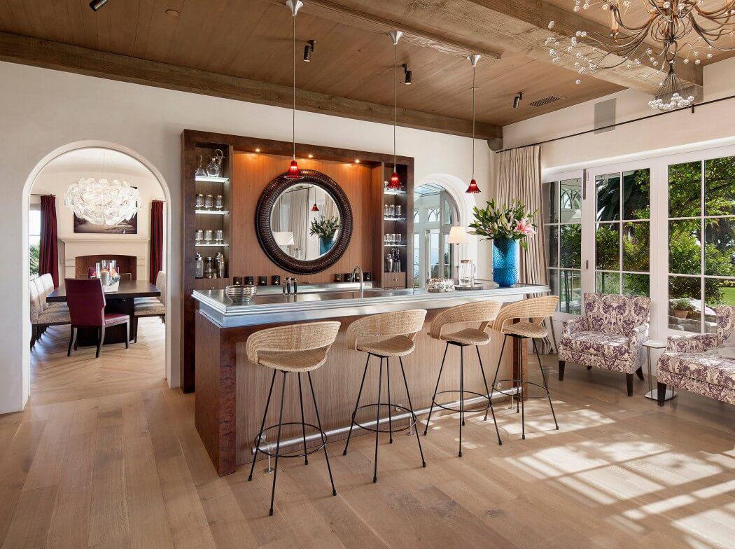 Maison traditionnelle de standing santa barbara aux for Comptoir bar design maison