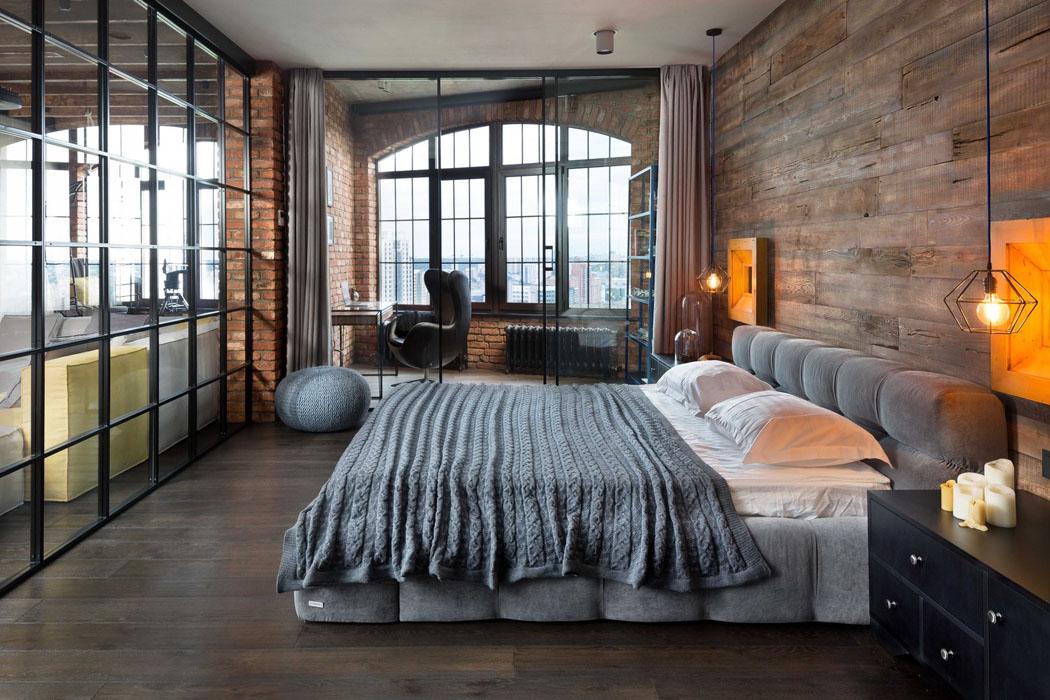 la seule chambre de ce loft industriel avec un grand lit moelleux - Chambre Loft Industriel