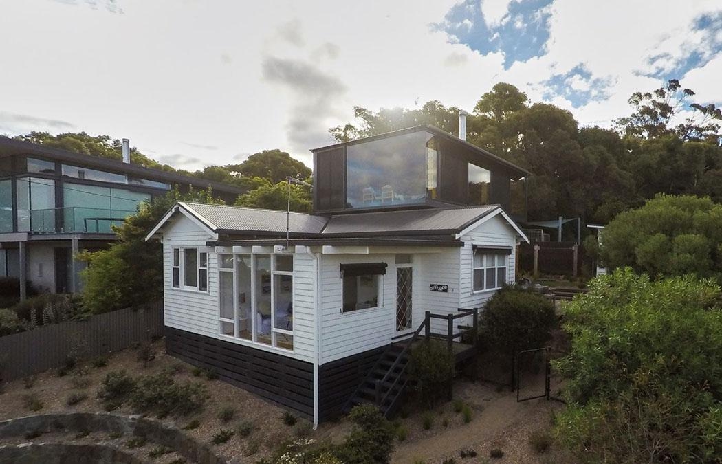 Un agrandissement de maison en bois pour donner un coup de - Petite extension maison ...