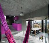 maison originale en béton et verre suisse