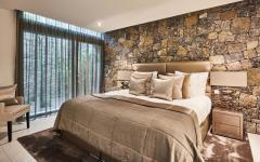 chambre moderne et rustique mur en pierre villa de luxe