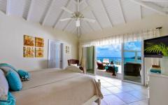 chambre à coucher turquoise vue sur la mer