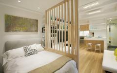 coin lit séparé espace séjour studio de ville