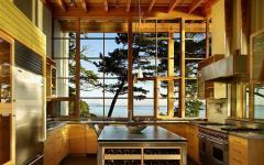 baie vitrée vue splendide sur lac maison en bois