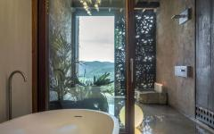Belle salle de bains avec béton ciré