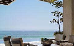 salon vue panoramique sur la mer eau turquoise exotique